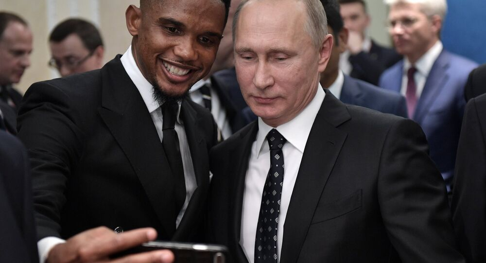 Russian President Vladimir Putin and Cameroonian footballer Samuel Eto'o, left, during the meeting of the Russian President with world football stars held before the official final draw ceremony of the 2018 FIFA World Cup.