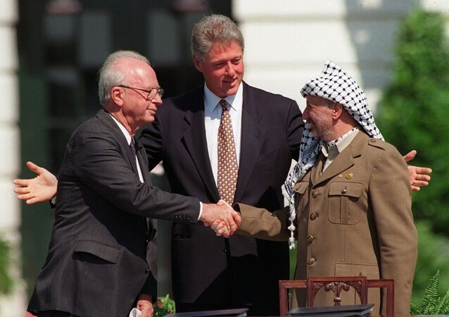 President Bill Clinton presides over ceremonies marking the signing of the 1993 peace accord between Israel and the Palestinians on the White House lawn with Israeli Prime Minister Yitzhak Rabin, left, and PLO chairman Yasser Arafat, right