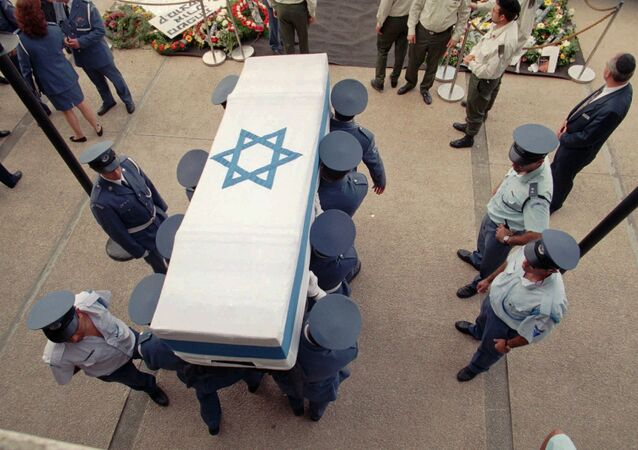 Israeli soldiers carry the flag-draped coffin of Prime Minister Yitzhak Rabin Monday, November 6, 1995 from the Knesset where it laid at state to be brought to its final resting place at Mt. Herzl in Jerusalem