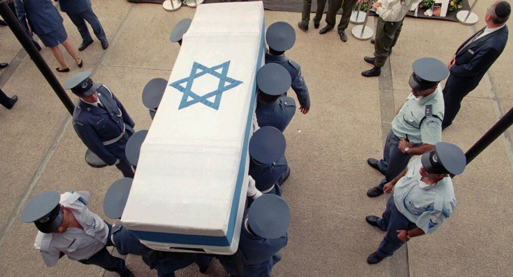 Israeli soldiers carry the flag-draped coffin of Prime Minister Yitzhak Rabin Monday, 6 November 1995 from the Knesset where it laid at state to be brought to its final resting place at Mt. Herzl in Jerusalem