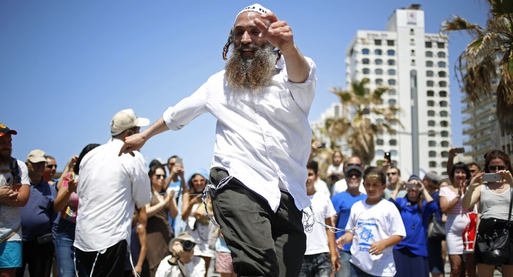 People dance during Independence Day celebrations marking 70 years since the founding of the state in 1948, in Tel Aviv, Israel