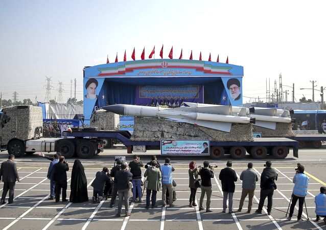 In front of the portraits of supreme leader Ayatollah Ali Khamenei, right, and the late revolutionary founder Ayatollah Khomeini, left, a missile is displayed by Iran's army during a parade marking National Army Day at the mausoleum of Khomeini, just outside Tehran, Iran, Wednesday, April 18, 2018.