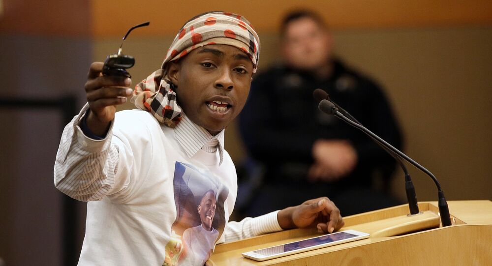 FILE--In this April 10, 2018, file photo, Stevante Clark, the brother of Stephon Clark, who was shot and killed by Sacramento police, speaks before a meeting of the Sacramento City Council in Sacramento, Calif. Clark was arrested on Thursday, April 19, 2018, and accused of making threats to commit a crime resulting in death or great bodily injury and telephoning 911 with the intent to annoy or harass.