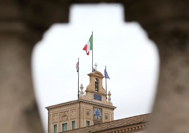 The Italian flag flutters at the Quirinal Palace during the two-day talks on government formation, after March national elections, in Rome, Italy, April 4, 2018