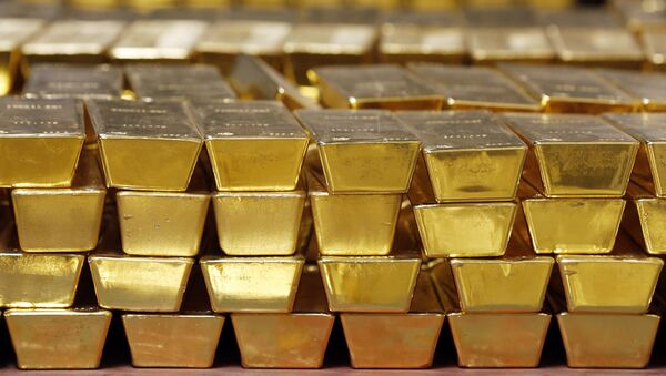 In this Tuesday, July 22, 2014, file photo, gold bars are stacked in a vault at the United States Mint, in West Point, N.Y. - Sputnik International