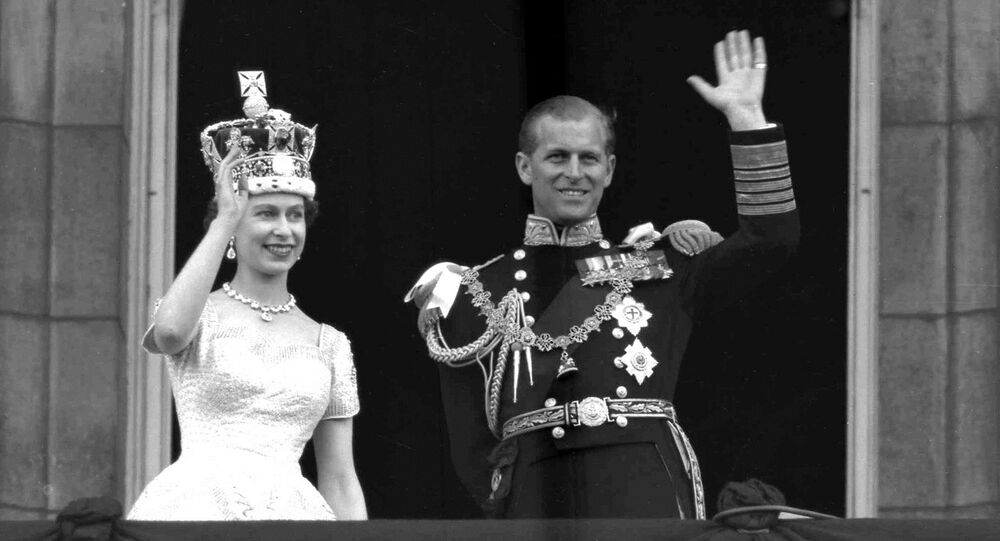 This is a June. 2, 1953 file photo of Britain's Queen Elizabeth II and Prince Philip, Duke of Edinburgh, as they wave to supporters from the balcony at Buckingham Palace, following her coronation at Westminster Abbey. London