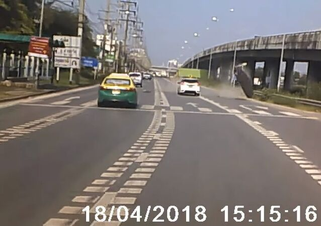 Flying Cement Lid Nearly Crashes into Cars