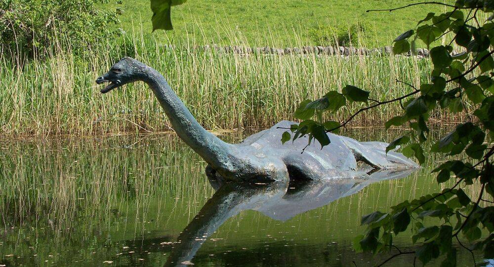 In this June 2006 file photo a model monster replica of the legendary sea serpent of Loch Ness, Nessie, provides a photo op for visitors in Drumnadrochit, Scotland