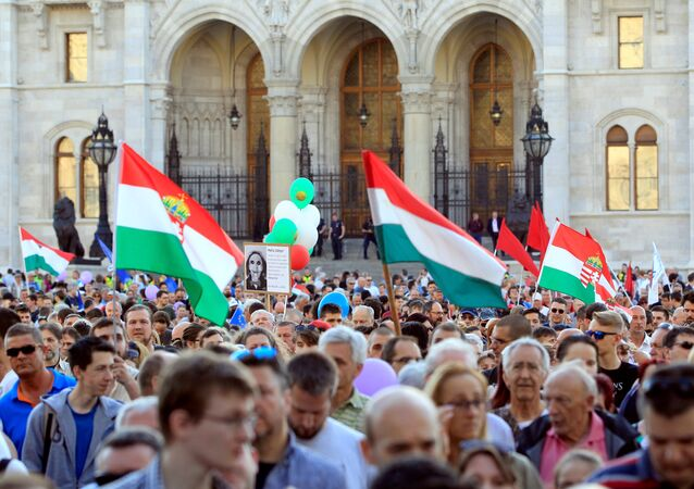 People attend a protest against the government of Prime Minister Viktor Orban in Budapest, Hungary, April 21, 2018