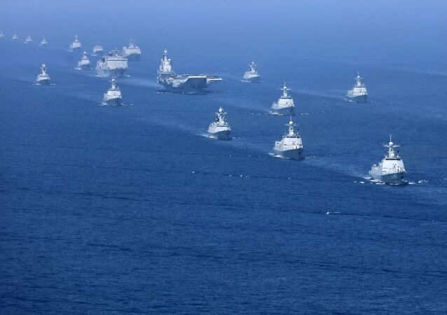 In this 12 April, 2018 photo released by Xinhua News Agency, the Liaoning aircraft carrier is accompanied by navy frigates and submarines conducting an exercises in the South China Sea
