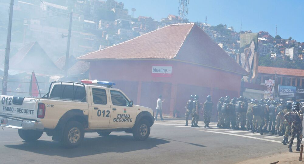 Riot police fire tear gas canisters disperse opposition demonstrators protesting against new electoral laws in Antananarivo, Madagascar April 21, 2018.