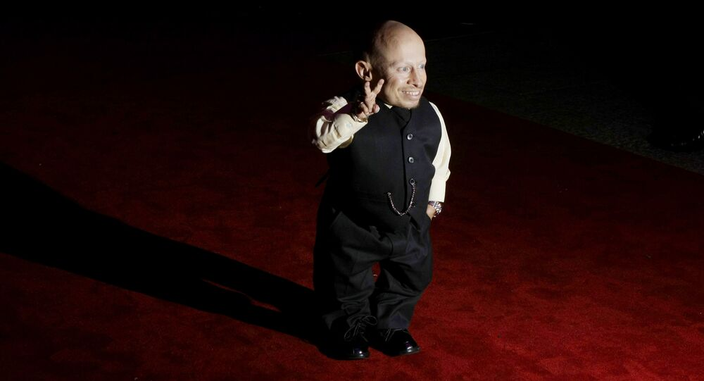Cast member Verne Troyer poses for photographs as he arrives at the gala premiere of the film The Imaginarium of Doctor Parnassus at a cinema in London, Tuesday Oct. 6, 2009