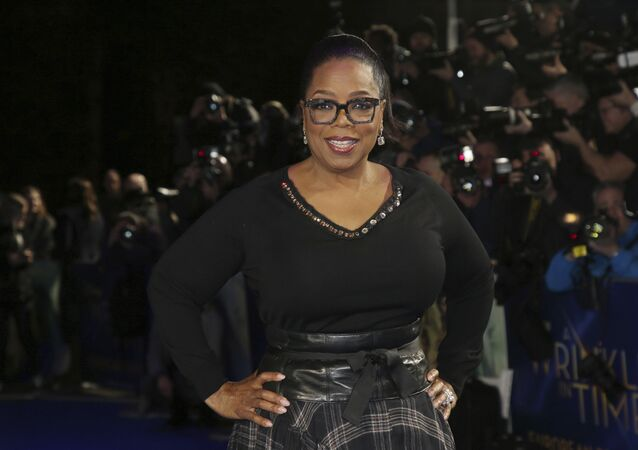 Actress Oprah Winfrey poses for photographers upon arrival at the premiere of the film 'A Wrinkle In Time' in London, Tuesday, March 13, 2018
