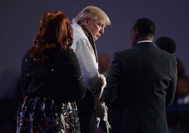 Donald Trump wears a prayer shawl during a church service