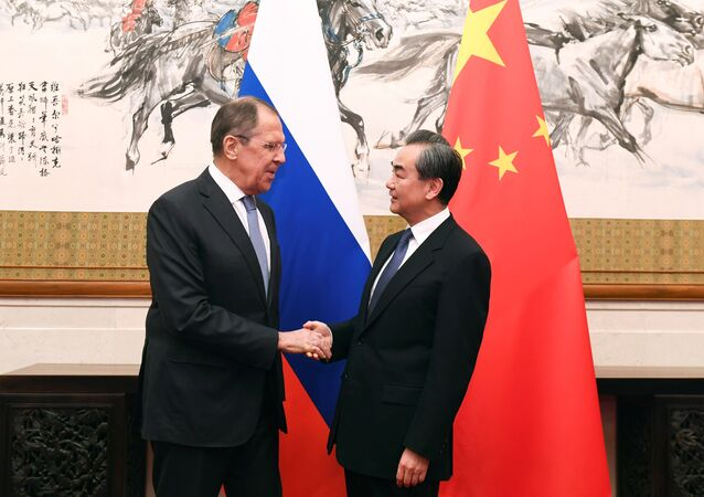 Russian Foreign Minister Sergei Lavrov shakes hands with Chinese State Councilor and Foreign Minister Wang Yi at the Diaoyutai State Guest House in Beijing, China, April 23, 2018