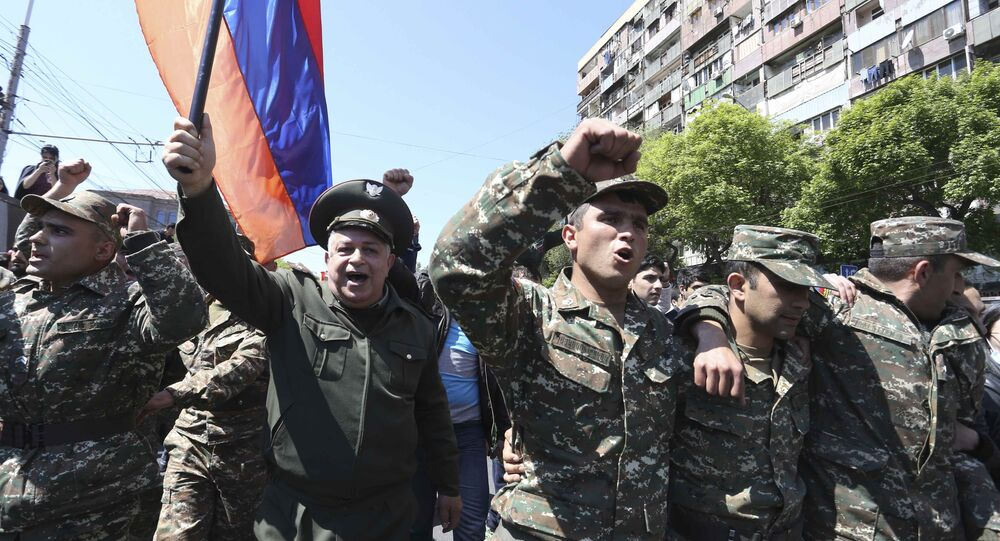 People march during a protest against the appointment of ex-president Serzh Sarksyan as the new prime minister in Yerevan, Armenia April 23, 2018
