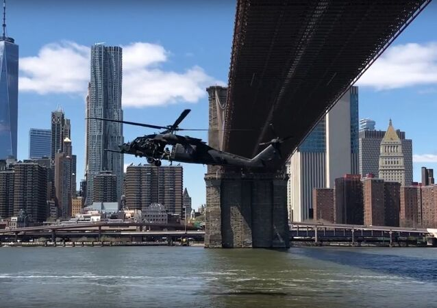 Military helicopter flyby underneath the Brooklyn Bridge in NYC