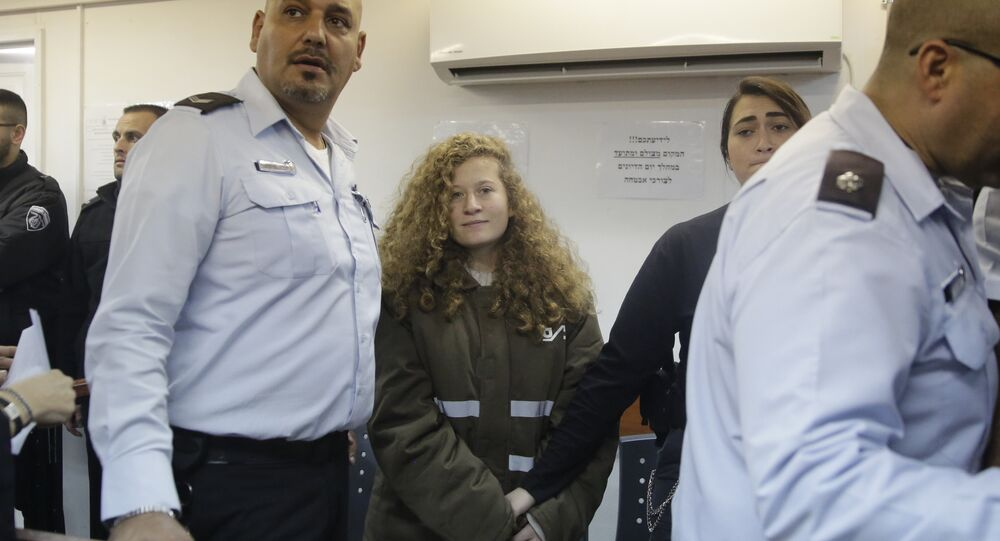 Ahed Tamimi is brought to a courtroom inside the Ofer military prison near Jerusalem, Monday, Jan. 15, 2018
