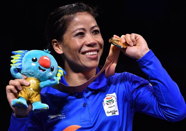 India's Mary Kom poses with her gold medal after beating Northern Ireland's Kristina O'Hara in their women's 45-48kg final boxing match during the 2018 Gold Coast Commonwealth Games at the Oxenford Studios venue on the Gold Coast on April 14, 2018