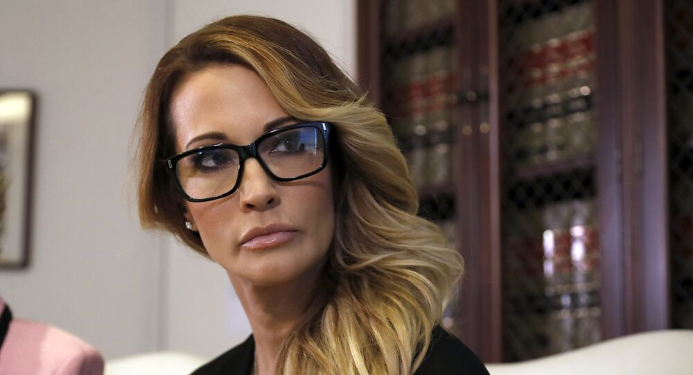 Jessica Drake listens to a question during a news conference at the office of her attorney, Gloria Allred, in Los Angeles on Saturday, Oct. 22, 2016.