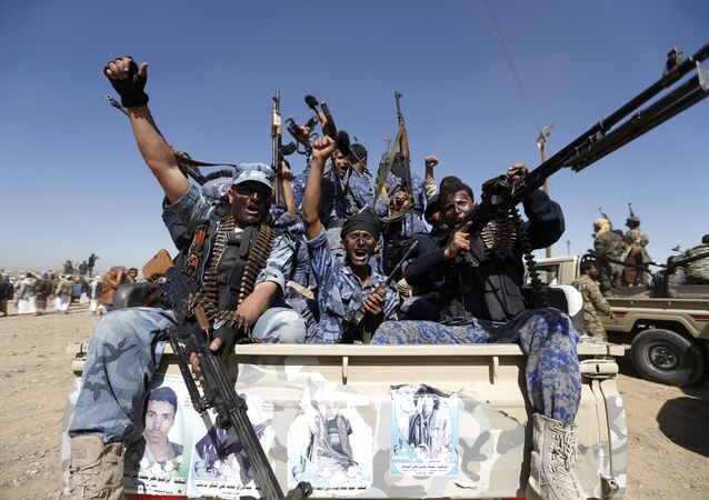Houthi fighters chant slogans as they ride a military vehicle during a gathering in the capital Sanaa to mobilize more fighters to battlefronts to fight pro-government forces in several Yemeni cities (File)