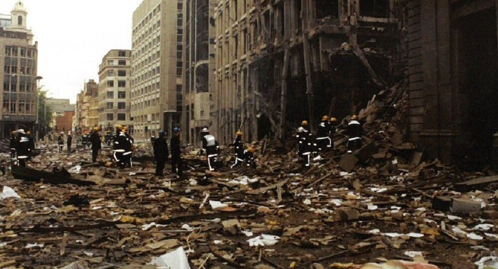 Firemen inspect the damage in Bishopsgate after the blast in April 1993