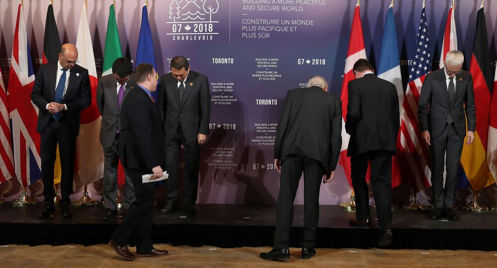 Security ministers and foreign ministers search for their name tags prior to a group photo on the second day of meetings for foreign ministers from G7 countries in Toronto, Ontario, Canada April 23, 2018