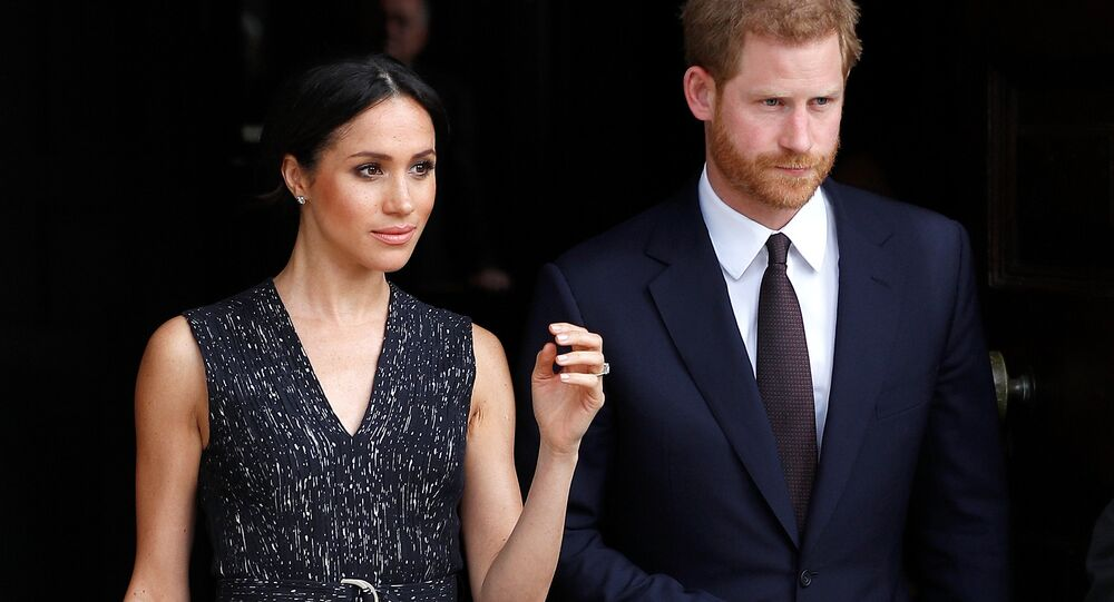 Britain's Prince Harry and his fiancee Meghan Markle leave a service at St Martin-in-The Fields to mark 25 years since Stephen Lawrence was killed in a racially motivated attack, in London, Britain, April 23, 2018