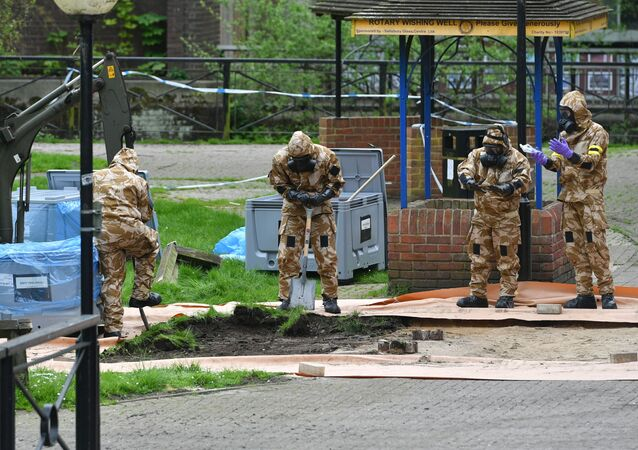 Military personnel dig near the area where Russian agent Sergei Skripal and his daughter Yulia were found on a park bench, in Salisbury, England, Tuesday April 24, 2018