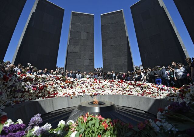 The ceremony of laying flowers at the eternal flame at the Armenian Genocide Victims Memorial in Yerevan