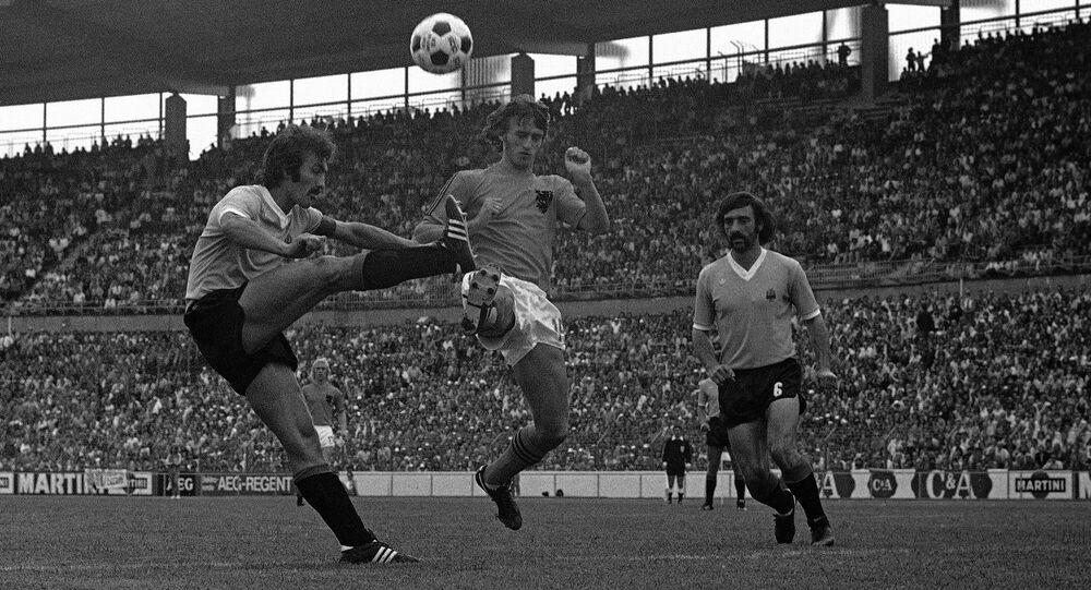 Holland's Johan Cruyff takes on two Uruguay defenders in the 1974 World Cup