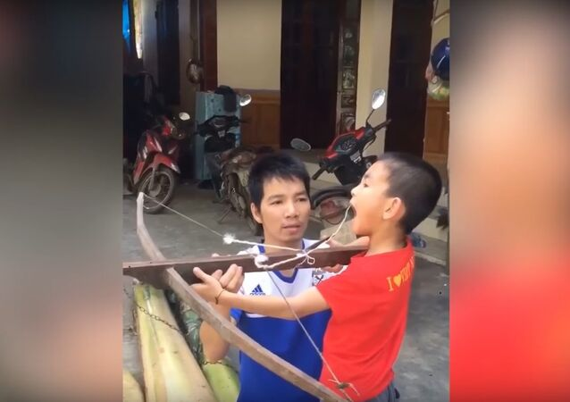 Boy Fires Crossbow for Loose Tooth Removal