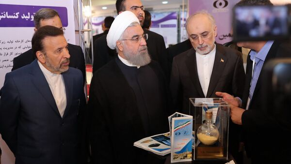 President Hassan Rouhani listens to explanations on new nuclear achievements at a ceremony to mark National Nuclear Day, in Tehran, Iran, Monday, April 9, 2018 - Sputnik International