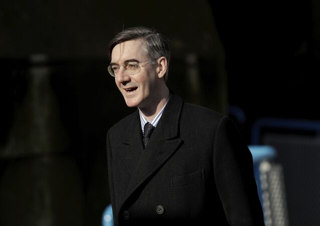 British Conservative Party Member of Parliament (MP) and Brexiteer Jacob Rees-Mogg arrives to speak to the media on Embankment Pier without boarding a fishing boat that went on to take part in a protest stunt with fish being thrown off it into the River Thames outside the Houses of Parliament in London, Wednesday, March 21, 2018