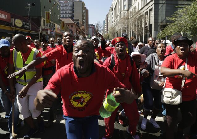 South Africa Federation Of Trade Unions (SAFTU) protesters gather in downtown Johannesburg, Wednesday, April 25, 2018, ahead of a march against the national minimum wage and the proposed changes in the labour laws