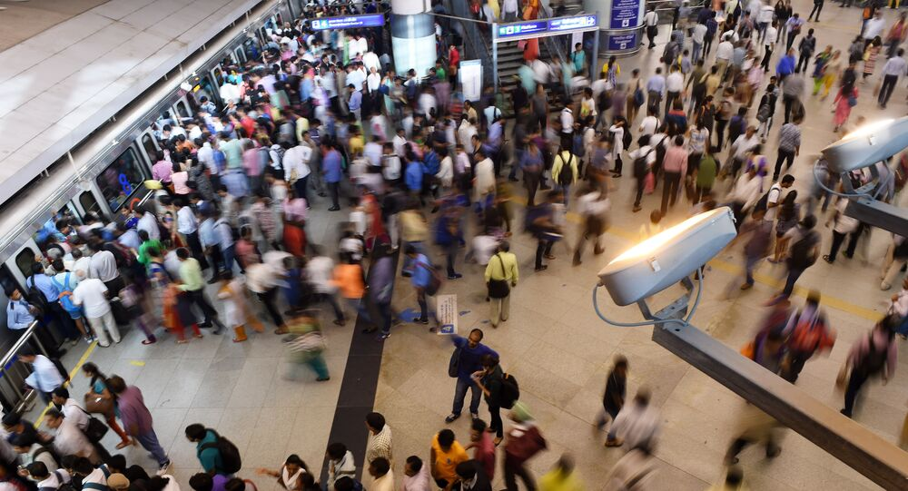 Indian commuters make their way through a metro station at rush hour in New Delhi on July 11, 2016