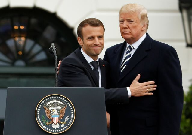 U.S. President Donald Trump and French President Emmanuel Macron attend an arrival ceremony at the White House in Washington, U.S., April 24, 2018