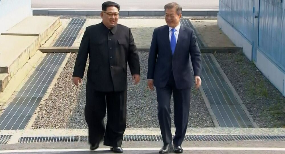 In this image taken from video provided by Korea Broadcasting System (KBS) Friday, April 27, 2018, North Korean leader Kim Jong Un, left, and South Korean President Moon Jae-in walk together as Kim crossed the border into South Korea for their historic face-to-face talks, in Panmunjom.