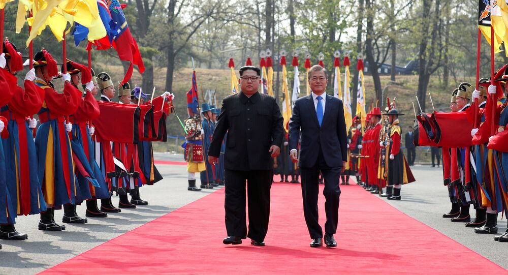 South Korean President Moon Jae-in walks with North Korean leader Kim Jong Un at the truce village of Panmunjom inside the demilitarized zone separating the two Koreas, South Korea, April 27, 2018