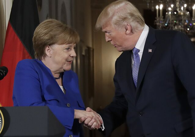 President Donald Trump shakes hands with German Chancellor Angela Merkel during a news conference in the East Room of the White House, Friday, April 27, 2018, in Washington.
