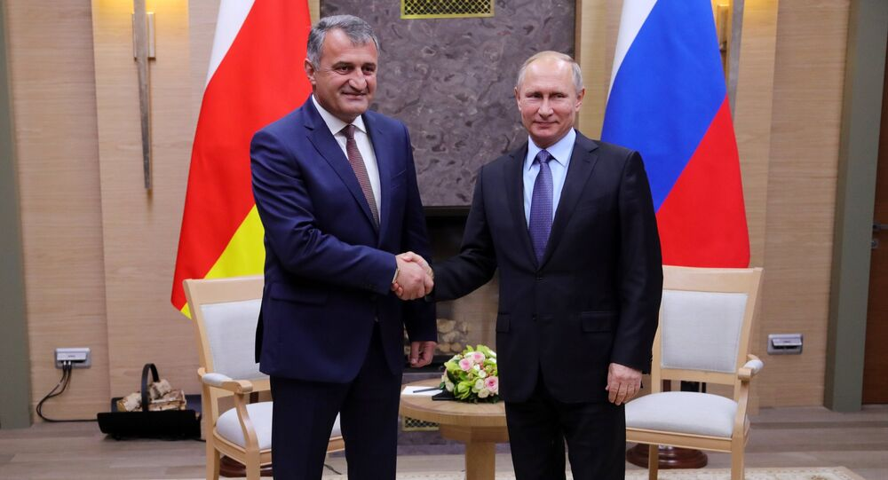 Russian President Vladimir Putin and President of South Ossetia Anatoly Bibilov, left, during a meeting. File photo