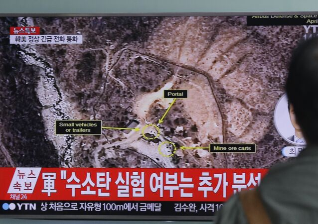 In this Sept. 9, 2016 file photo, a man watches a TV news program reporting North Korea's nuclear test at Seoul Railway Station in Seoul, South Korea