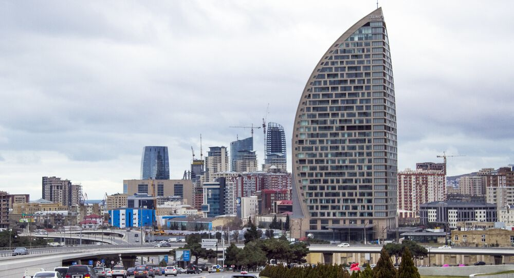 In this Feb. 19, 2016, file photo, The Trump International Hotel, the highest building, is seen in Baku, Azerbaijan