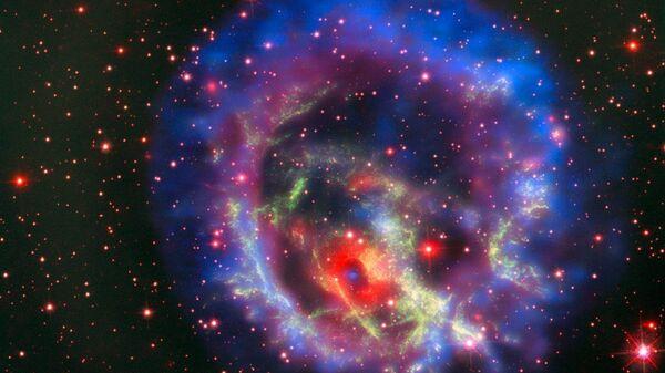 Остатки сверхновой 1E 0102.2-7219, расположенной в ближайшей к нам галактике Малое Магелланово Облако - Sputnik International