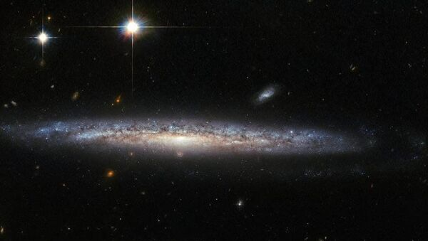 This image, captured by the Advanced Camera for Surveys (ACS) on the NASA/ESA Hubble Space Telescope, shows the spiral galaxy NGC 5714, about 130 million light-years away in the constellation of Boötes (the Herdsman) - Sputnik International