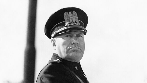 Benito Mussolini, in the newly introduced Fascist uniform, on his horse at a parade of police to commemorate the 13th anniversary of the foundation of the Metropolitan Police in Rome, Italy around Oct. 20, 1938 - Sputnik International