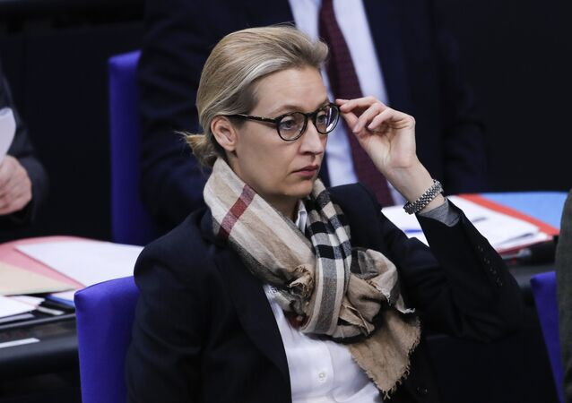 Alice Weidel parliament faction co-leader of the Alternative for Germany, AfD, party, arrives at the German parliament Bundestag prior to a debate about refugee policy in Germany, in Berlin, Friday, Jan. 19, 2018