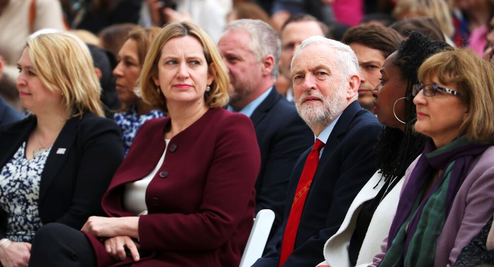 Britain's Home Secretary Amber Rudd sits next to Jeremy Corbyn, the leader of the Labour Party as they attend the unveiling of the statue of suffragist Millicent Fawcett on Parliament Square, in London, Britain, April 24, 2018