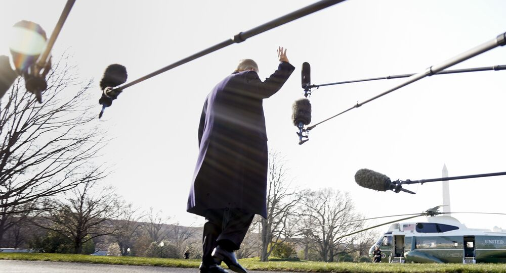 President Donald Trump waves before boarding Marine One on the South Lawn of the White House in Washington, Tuesday, March 13, 2018