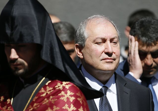 Armenian President Armen Sarkissian attends a wreath laying ceremony to commemorate the 103rd anniversary of mass killing of Armenians by Ottoman Turks, at the Tsitsernakaberd Memorial Complex in Yerevan, Armenia April 24, 2018